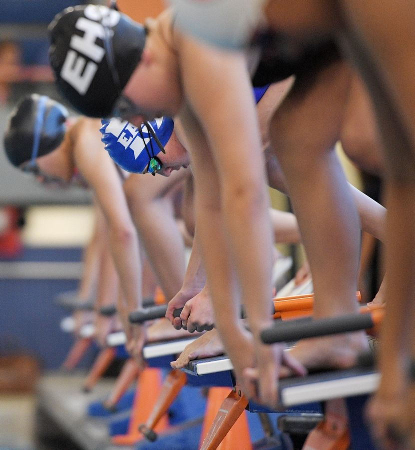 Maine East's Irene Lazanyl gets set on the starting block for the 50-yard freestyle at the Hoffman Estates girls swim invitational Saturday.