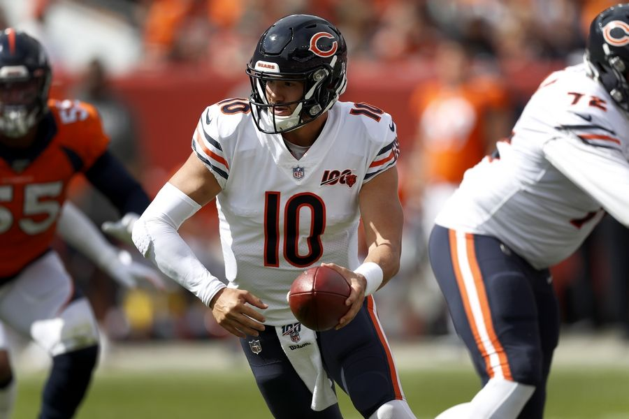 Chicago Bears quarterback Mitchell Trubisky (10) hands off against the Denver Broncos during the first half of an NFL football game, Sunday, Sept. 15, 2019, in Denver.