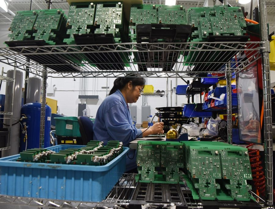 Chiengkham Luangphixay solders circuit boards at the Morley facility in Glendale Heights.