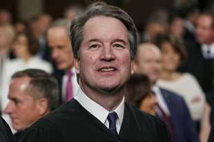 Supreme Court Associate Justice Brett Kavanaugh, shown here watching as President Donald Trump arriving to give his State of the Union address, is facing a new allegation of sexual misconduct while a college student.