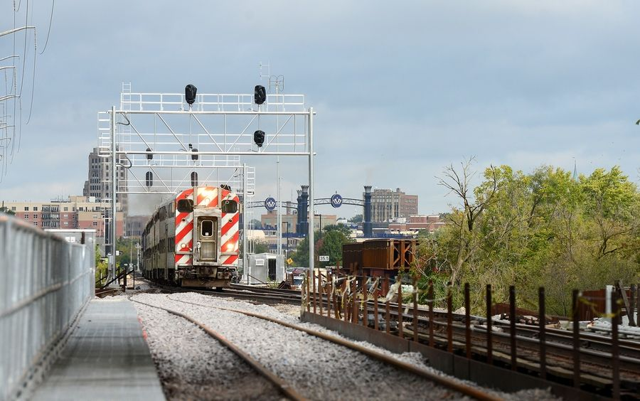 Construction of Metra's new Fox River railway bridge in Elgin faced heavy rains, endangered mussels and other challenges. When the second stage of construction is completed next fall, it will significantly cut delays. The new track on the left opened Saturday.