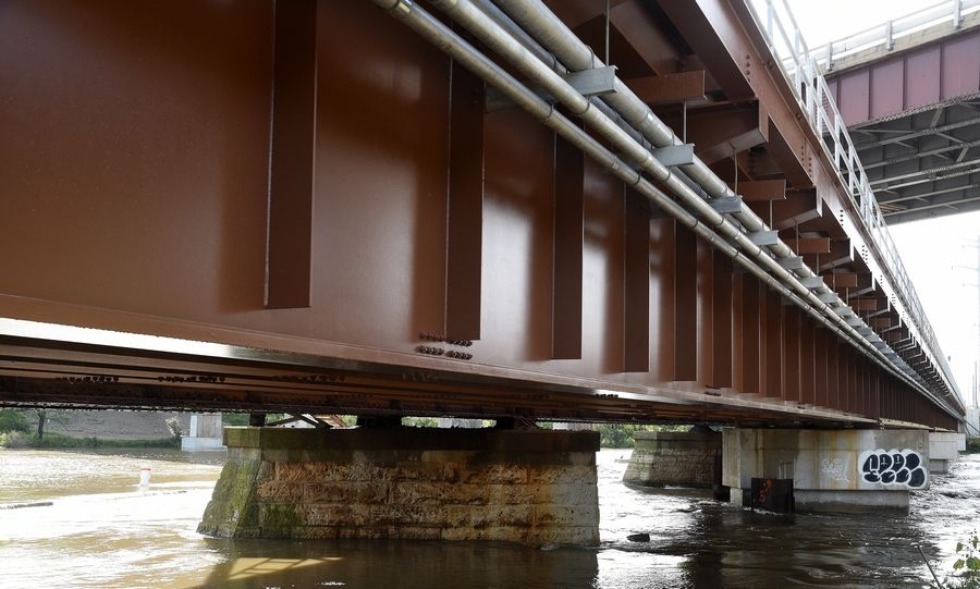 Old limestone piers on the left contrast with the concrete ones of Metra's new Fox River railway bridge in Elgin.