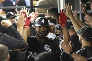 Eloy Jimenez celebrates his grand slam off Kansas City's Jakob Junis last Tuesday in the White Sox's victory.
