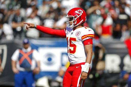 Kansas City Chiefs quarterback Patrick Mahomes calls out a play during the second half of an NFL football game against the Oakland Raiders Sunday, Sept. 15, 2019, in Oakland, Calif.