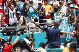 New England Patriots wide receiver Antonio Brown (17) waves from the seats after scoring a touchdown, during the first half at an NFL football game against the Miami Dolphins, Sunday, Sept. 15, 2019, in Miami Gardens, Fla. (AP Photo/Wilfredo Lee)
