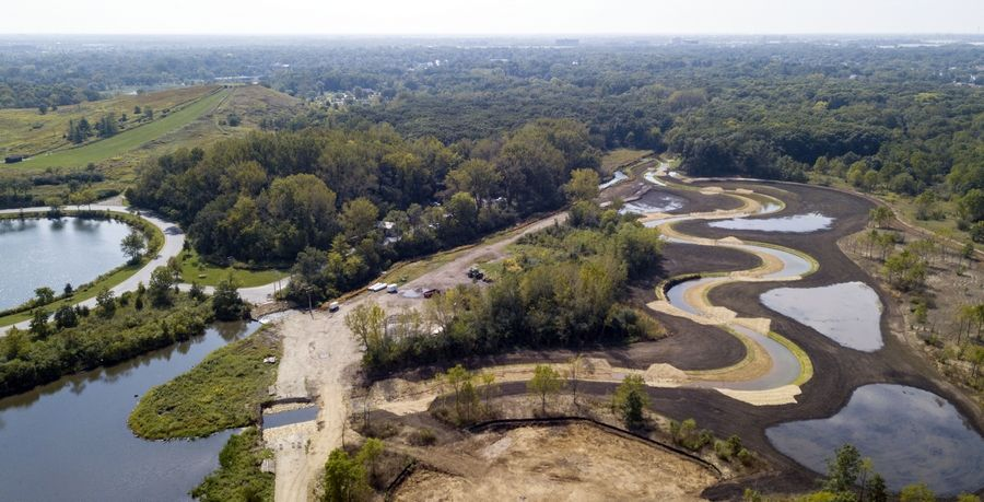 An aerial view looking southwest toward the West Division Ranger office and the sledding hill at Blackwell Forest Preserve of the restoration work being done along Springbrook near Warrenville.