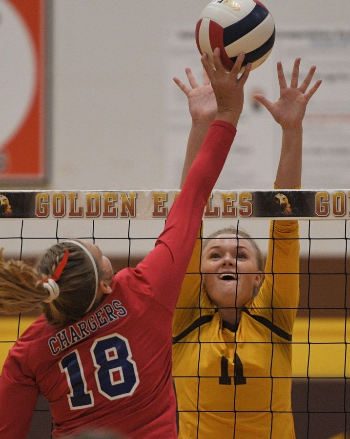 Dundee-Crown's MacKenzie Field taps the ball toward Jacobs' Maggie Wallenberger in a girls volleyball match in Algonquin Tuesday.