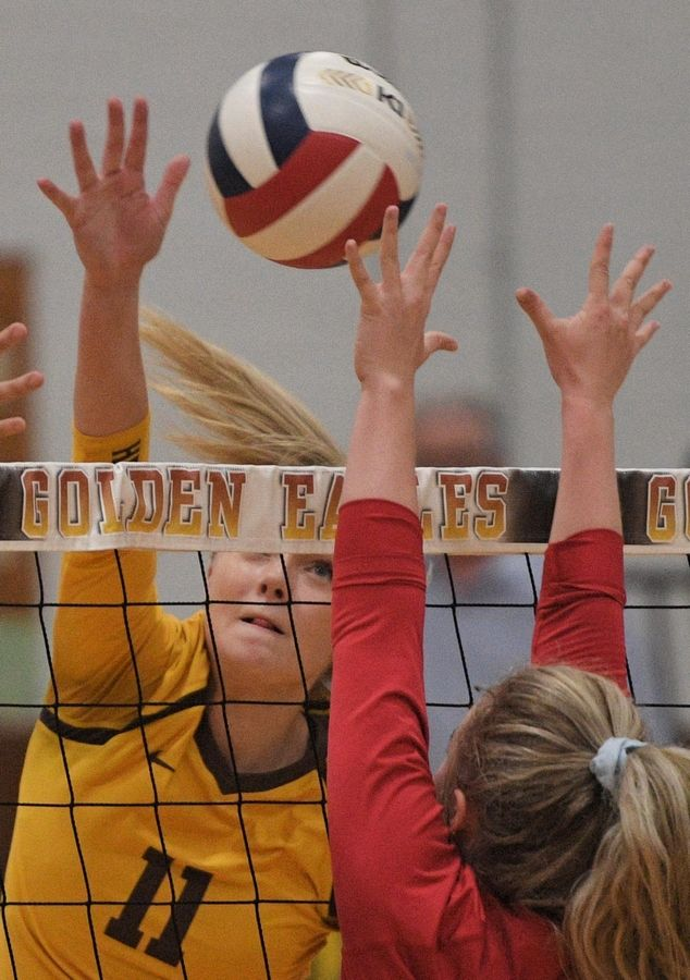 Jacobs' Maggie Wallenberger hits toward Dundee-Crown's Jenna Brown in a girls volleyball match in Algonquin Tuesday.