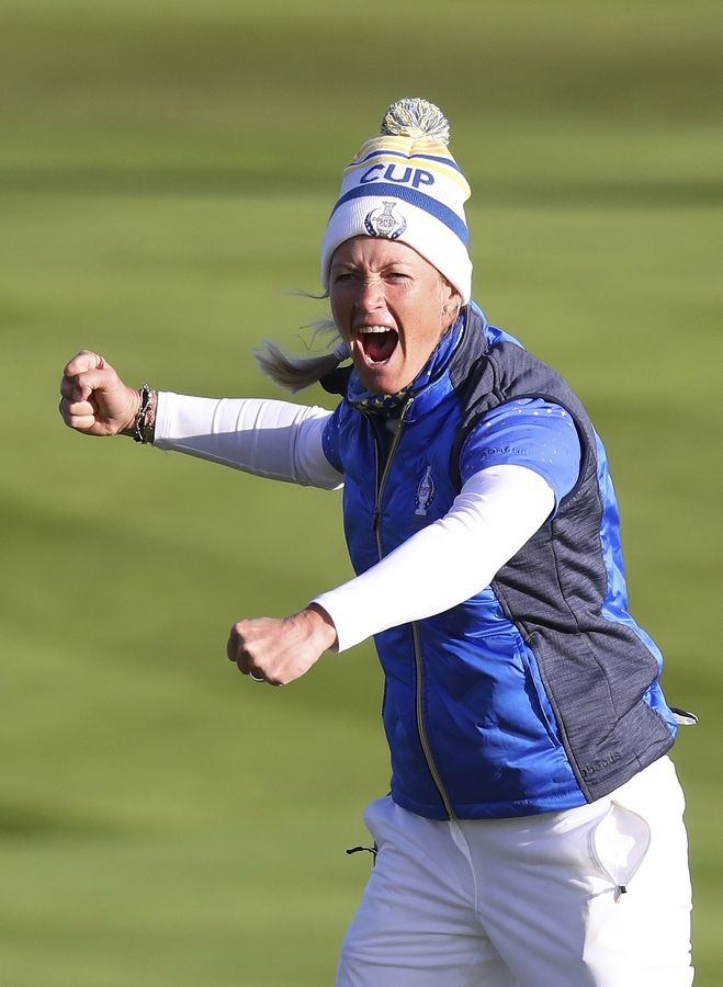 Suzann Pettersen of Europe celebrates after holing a putt on the 18th green to win the Solheim cup against the US at Gleneagles, Auchterarder, Scotland, Sunday, Sept. 15, 2019.