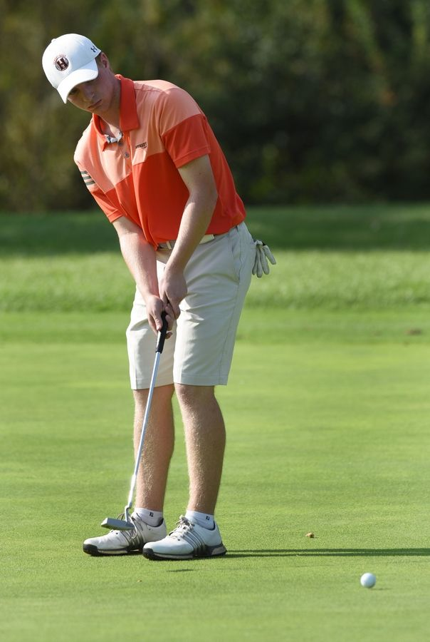 Hersey's Henry Quinn putts while competing at the Bridges at Poplar Creek golf course in Hoffman Estates Tuesday.