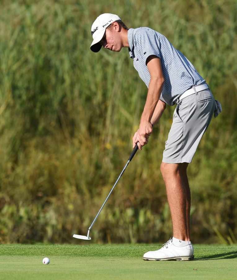 Conant's Nikko Ganas putts at the Bridges at Poplar Creek golf course in Hoffman Estates Tuesday.