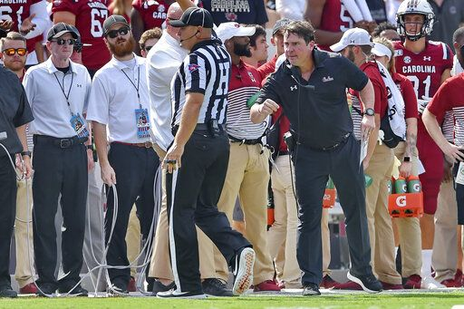 South Carolina head coach Will Muschamp has a word with an official during the first half of an NCAA college football game against Alabama Saturday, Sept. 14, 2019, in Columbia, S.C.