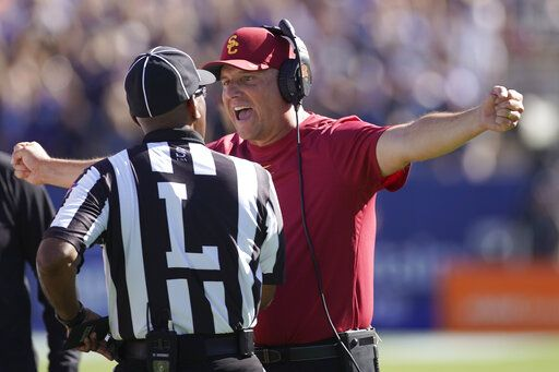 Southern California head coach Clay Helton argues with an official in the second half of an NCAA college football game against BYU, Saturday, Sept. 14, 2019, in Provo, Utah. BYU defeated USC 30-27.