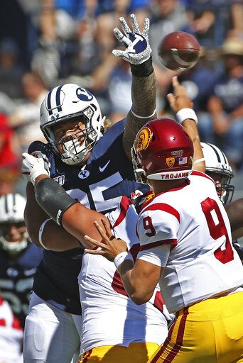 BYU defensive lineman Khyiris Tonga (95) tries to knock down a pass from Southern California quarterback Kedon Slovis (9) in the first half of an NCAA college football game, Saturday, Sept. 14, 2019, in Provo, Utah. BYU defeated USC 30-27.