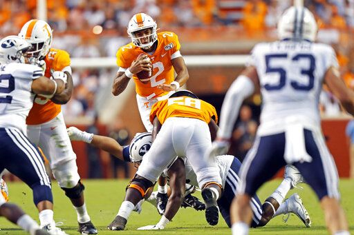 Tennessee quarterback Jarrett Guarantano (2) leaps over a Brigham Young defender in the first half of an NCAA college football game Saturday, Sept. 7, 2019, in Knoxville, Tenn.