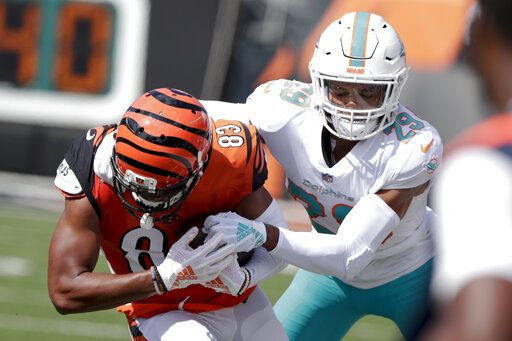 FILE - In this Oct. 7, 2018, file photo, Miami Dolphins' Minkah Fitzpatrick (29) tackles Cincinnati Bengals wide receiver Tyler Boyd (83) after a catch during the first half of an NFL football game in Cincinnati. A person familiar with the negotiations says Fitzpatrick has been traded to the Pittsburgh Steelers for a first-round draft pick in 2020. The person confirmed the trade to The Associated Press on condition of anonymity Monday, Sept. 16, 2019, night because the teams had not confirmed it.