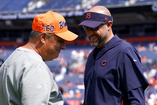 Denver Broncos head coach Vic Fangio, left, talks with Chicago Bears head coach Matt Nagy prior to an NFL football game, Sunday, Sept. 15, 2019, in Denver.