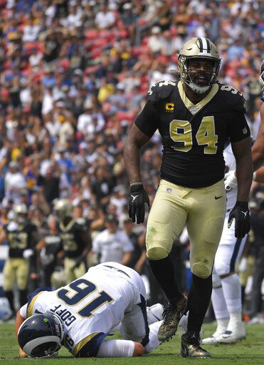 New Orleans Saints defensive end Cameron Jordan, right, celebrates after sacking Los Angeles Rams quarterback Jared Goff during the first half of an NFL football game Sunday, Sept. 15, 2019, in Los Angeles.