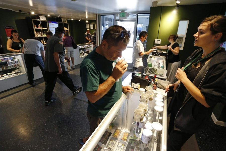 Customers shop for marijuana inside a recreational marijuana store, in Denver, Colorado. Antioch is among several communities wrestling with a decision to allow or ban retail sales of marijuana.