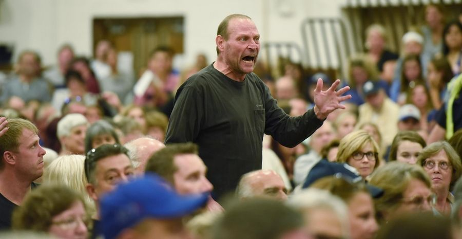 A resident stands to voice his opinion Wednesday as the Itasca plan commission postpones and continues a public hearing on a proposal to convert a hotel into a drug and alcohol treatment facility.