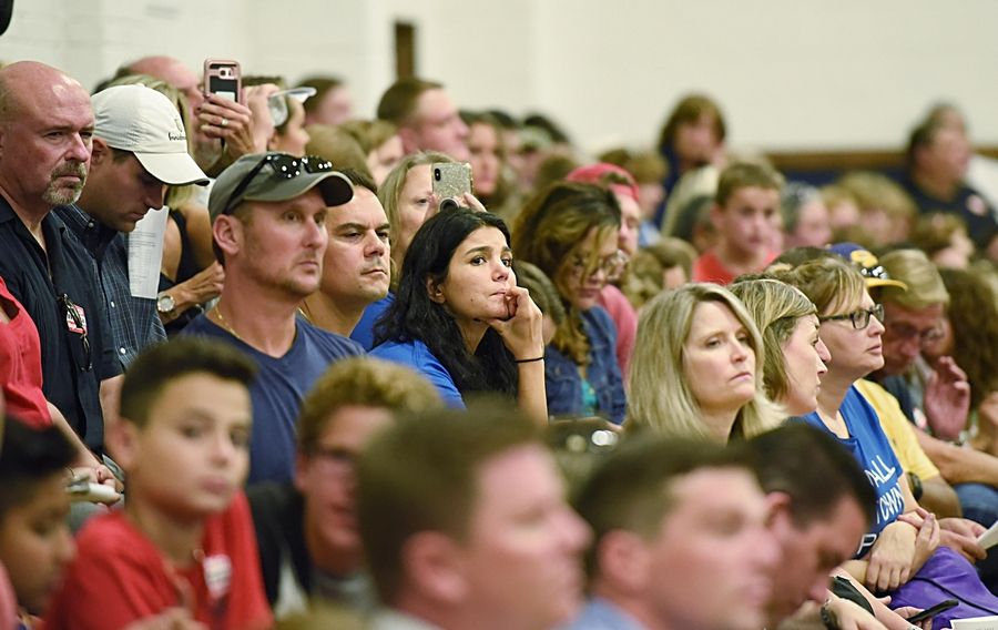 A packed gymnasium listens Wednesday as the Itasca plan commission postpones a public hearing on Haymarket Center's request to convert a hotel into a drug and alcohol treatment facility.