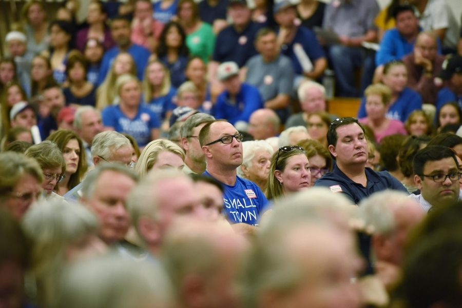 Crowds flooded a junior high gymnasium Wednesday, forcing the Itasca plan commission to postpone a public hearing on a proposed 200-bed drug and alcohol treatment facility.