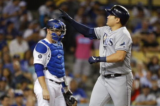 Tampa Bay Rays' Ji-Man Choi, right, celebrates next to Los Angeles Dodgers catcher Will Smith after a home run during the sixth inning of a baseball game in Los Angeles, Tuesday, Sept. 17, 2019.