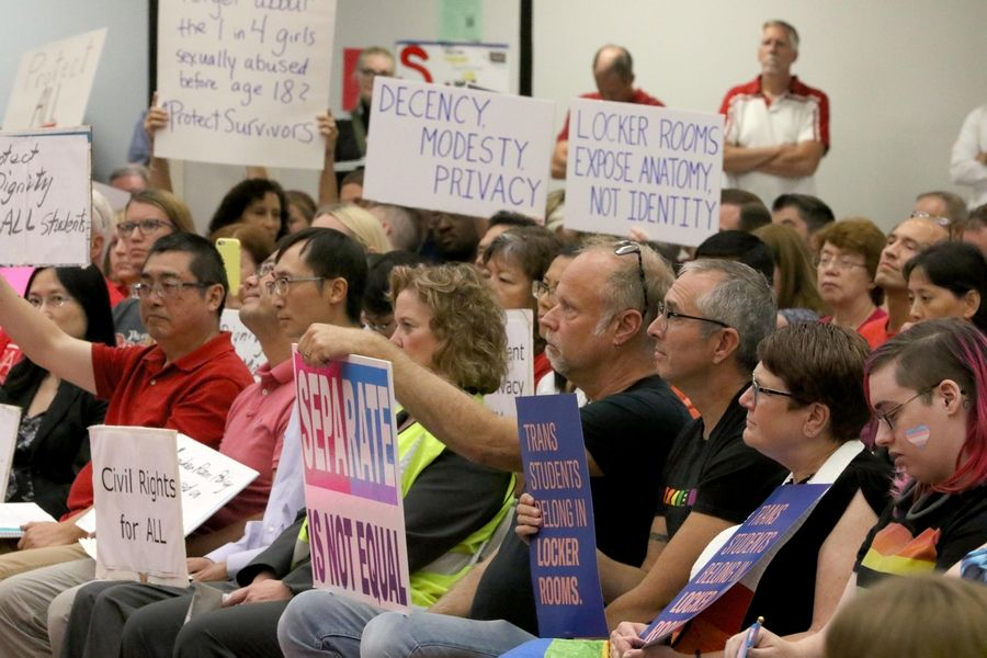 Both supporters of a policy that would allow transgender students to use the locker rooms of their choice, without a previous requirement that they change in privacy stalls, and opponents crowded the District 211 meeting at Palatine High School.