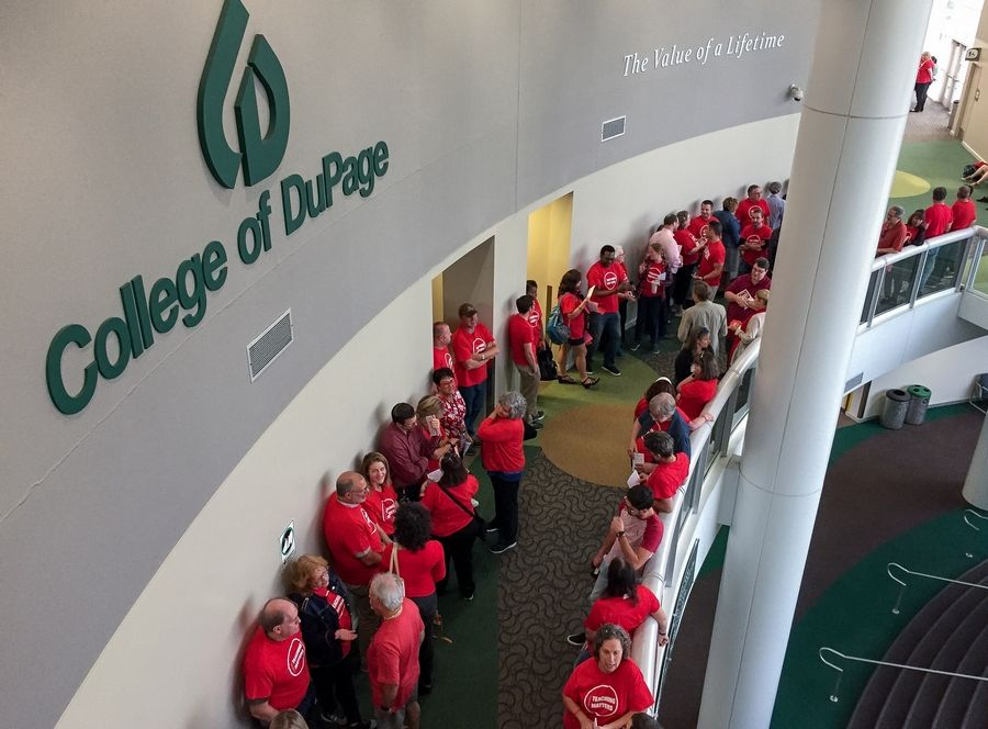 Full-time faculty members line up before the start of Thursday's College of DuPage board meeting. The faculty members have been working without a contract since a multiyear pact expired Aug. 14.