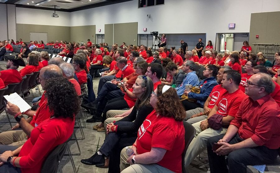 College of DuPage faculty members and their supporters -- many of them wearing red -- attended Thursday's board of trustees meeting to demand a fair contract.