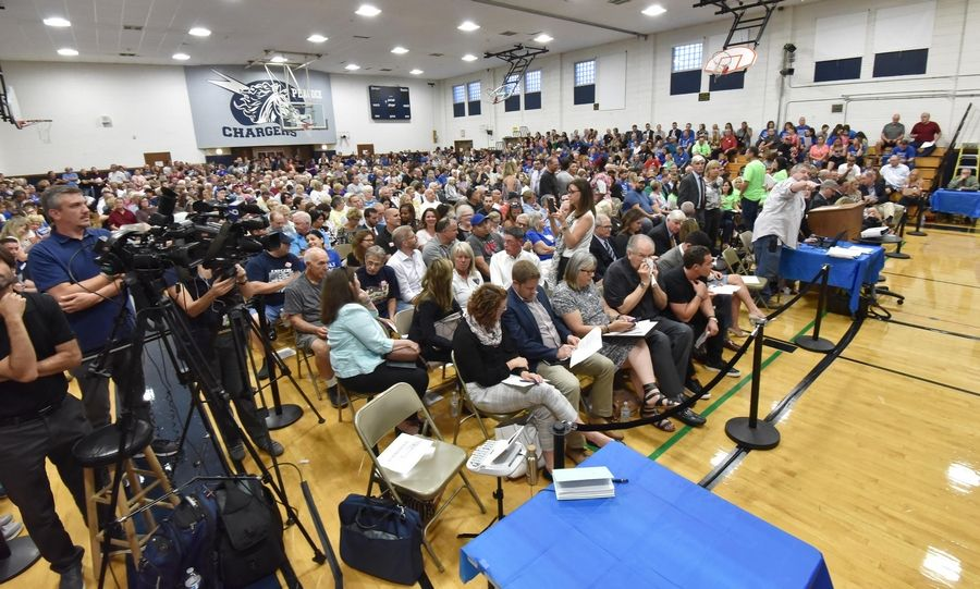 Only part of the crowd could fit into the Peacock Junior High gymnasium in Itasca Wednesday for a public hearing on a plan to convert a hotel into a drug and alcohol treatment facility. The village continued the hearing to Oct. 2.