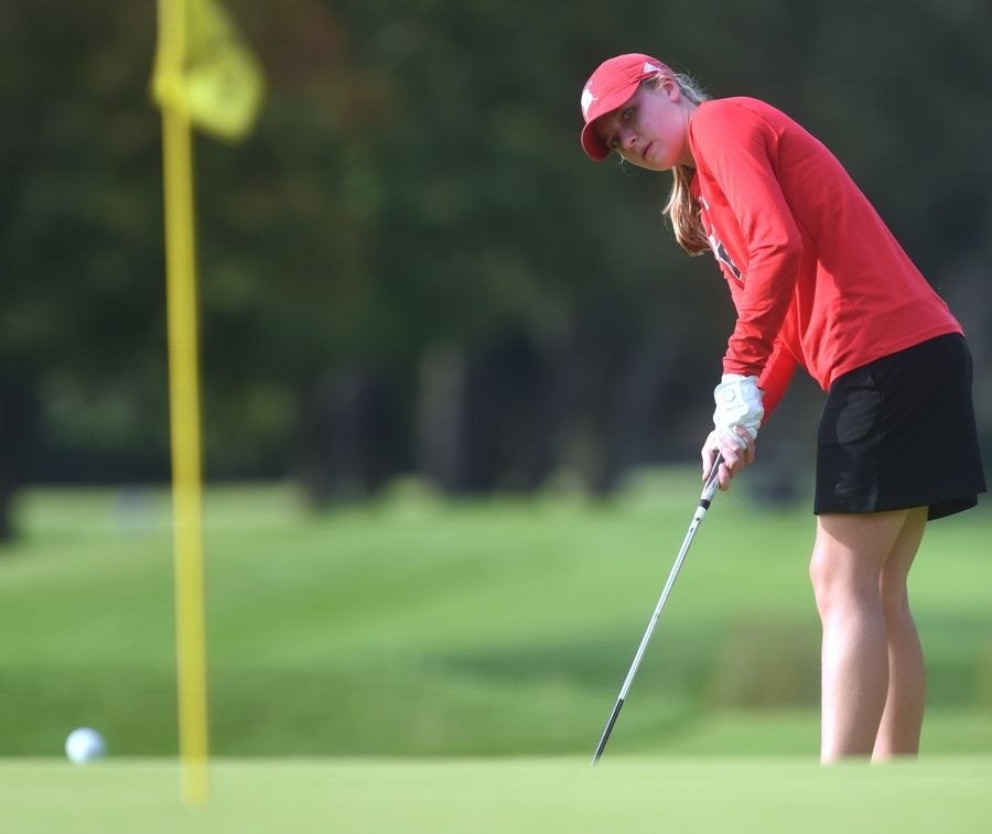 Barrington's Mara Janness watches her putt during Thursday's girls golf match against Prospect and Palatine at the Mount Prospect Golf Club.