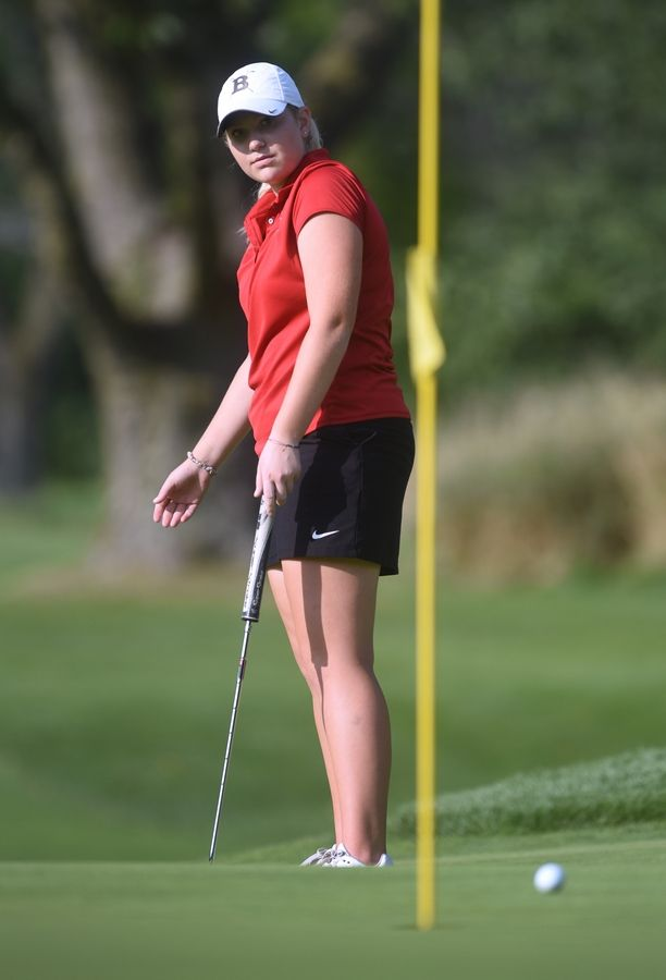 Barrington's Caroline Smith watches her putt during Thursday's girls golf match against Prospect and Palatine at the Mount Prospect Golf Club.