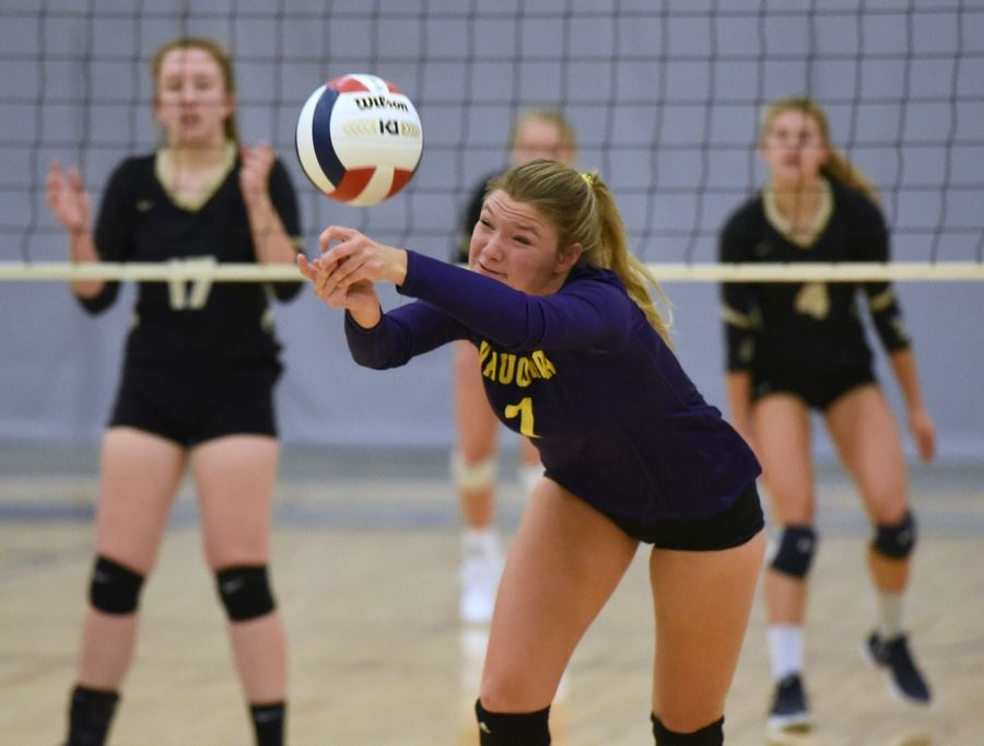 Wauconda's Savannah Johnson stretches for the ball during Thursday's girls volleyball match against Grayslake North in Grayslake.