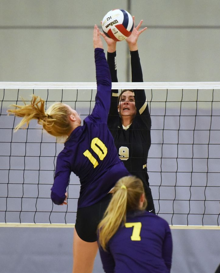 Grayslake North's Emily Bongiovanni-Schafer (9) goes up for the block against Wauconda's Tara Bierdz during Thursday's girls volleyball match in Grayslake.