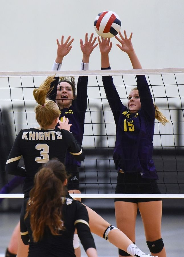 Wauconda's Emily Johnson and Delaney Lemay (15) go for the block against Grayslake North's Teagan Johnston during Thursday's girls volleyball match in Grayslake.
