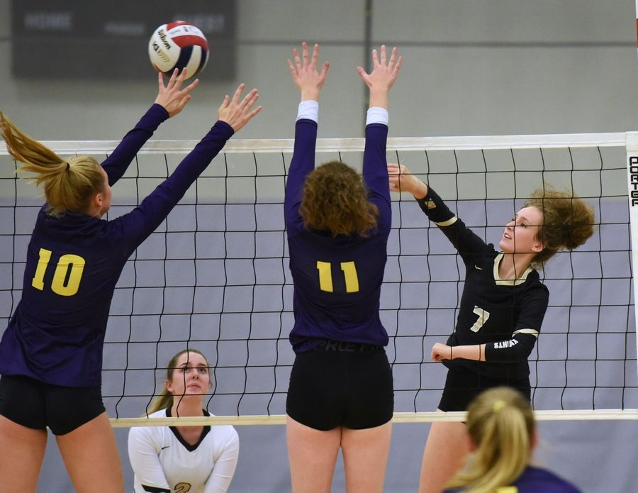 Grayslake North's Emily Porter (7) finds a hole past Wauconda's defense during Thursday's girls volleyball match in Grayslake.