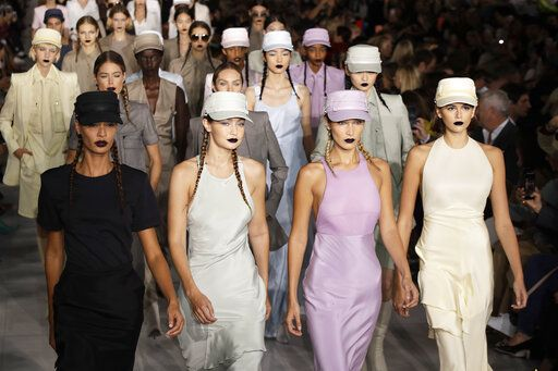 Models Gigi Hadid, from front second left, Bella Hadid and Kaia Gerber wear creations with other models as part of the Max Mara Spring-Summer 2020 collection, unveiled during the fashion week, in Milan, Italy, Thursday, Sept. 19, 2019.