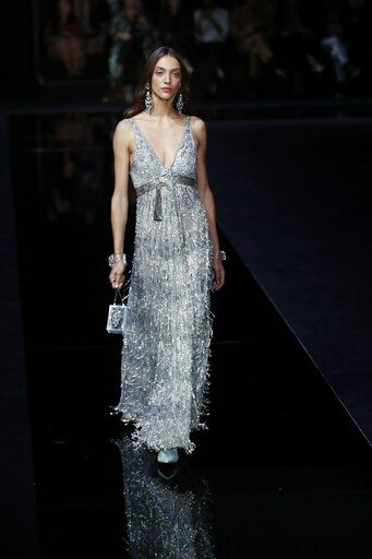 A model wears a creation as part of the Emporio Armani Spring-Summer 2020 collection, unveiled during the fashion week, in Milan, Italy, Thursday, Sept. 19, 2019.