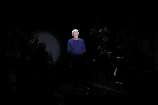 Designer Giorgio Armani accepts applause at the conclusion of the Emporio Armani Spring-Summer 2020 collection, unveiled during the fashion week, in Milan, Italy, Thursday, Sept. 19, 2019.