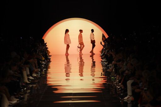 Models wear creations as part of the Fendi Spring-Summer 2020 collection, unveiled during the fashion week, in Milan, Italy, Thursday, Sept. 19, 2019.