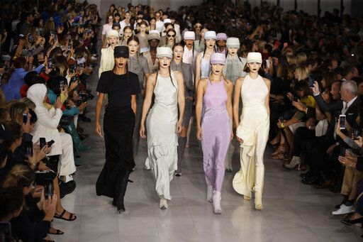 Models Joan Smalls, from front left, Gigi Hadid, Bella Hadid and Kaia Gerber wear creations with other models as part of the Max Mara Spring-Summer 2020 collection, unveiled during the fashion week, in Milan, Italy, Thursday, Sept. 19, 2019.