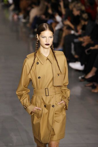 Model Faretta wears a creation as part of the Max Mara Spring-Summer 2020 collection, unveiled during the fashion week, in Milan, Italy, Thursday, Sept. 19, 2019.