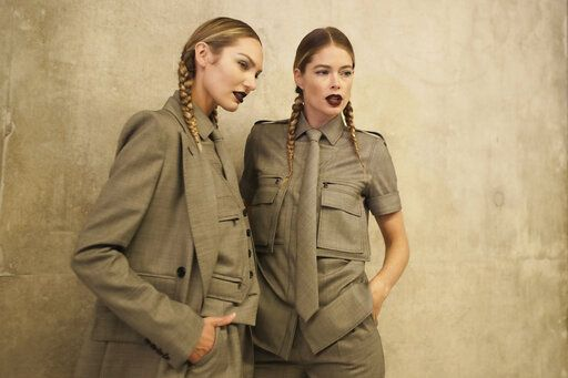 Models Candice Swanepoel, left, and Doutzen Kroes are photographed backstage prior to the Max Mara Spring-Summer 2020 collection, unveiled during the fashion week, in Milan, Italy, Thursday, Sept. 19, 2019.