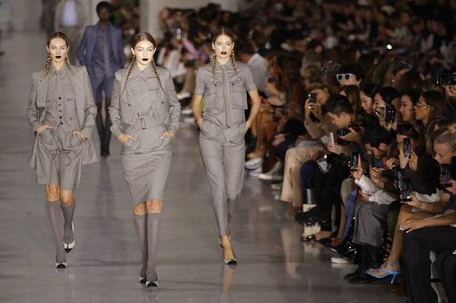 Models Candice Swanepoel, from left, Gigi Hadid and Doutzen Kroes wear creations as part of the Max Mara Spring-Summer 2020 collection, unveiled during the fashion week, in Milan, Italy, Thursday, Sept. 19, 2019.