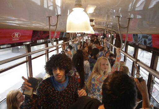 CORRECTS NAME OF BRAND  Models wear creations onboard a tram as part of the M Missoni Spring-Summer 2020 collection, unveiled during the fashion week, in Milan, Italy, Thursday, Sept. 19, 2019.