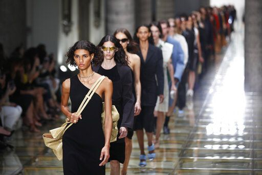 Models wear creations as part of the Bottega Veneta Spring-Summer 2020 collection, unveiled during the fashion week, in Milan, Italy, Thursday, Sept. 19, 2019.