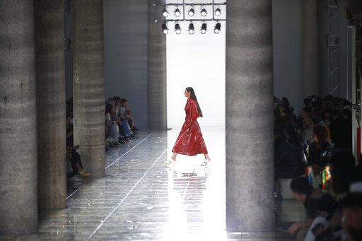 A model wears a creation as part of the Bottega Veneta Spring-Summer 2020 collection, unveiled during the fashion week, in Milan, Italy, Thursday, Sept. 19, 2019.
