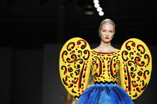 A model wears a creation as part of the Moschino Spring-Summer 2020 collection, unveiled during the fashion week, in Milan, Italy, Thursday, Sept. 19, 2019.
