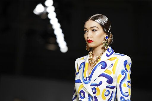 Model Gigi Hadid wears a creation as part of the Moschino Spring-Summer 2020 collection, unveiled during the fashion week, in Milan, Italy, Thursday, Sept. 19, 2019.
